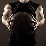 Basketball Player. Image of a basketball player holding a ball out in front of his body Royalty Free Stock Photo