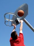 Basketball player. In motion jumping to the hoop Stock Photography