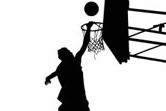 Basketball player. Silhouette of basketball player and hoop against deep blue sky Royalty Free Stock Photo