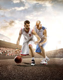 Basketball Player in action. On background of sky and crowd Stock Images