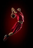 Basketball player in action is flying high Royalty Free Stock Images