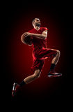 Basketball player in action is flying high Royalty Free Stock Photo