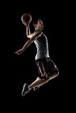Basketball player in action is flying high Stock Photos