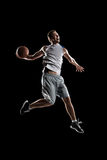 Basketball player in action is flying high Stock Image