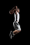 Basketball player in action is flying high Royalty Free Stock Photography