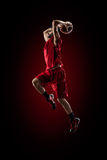 Basketball player in action is flying high Stock Photo