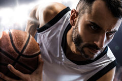 Basketball player in action is flying high Royalty Free Stock Photos
