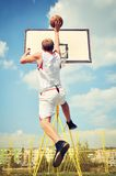 Basketball player in action flying high and scoring Royalty Free Stock Photos