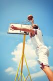 Basketball player in action flying high and scoring Stock Image