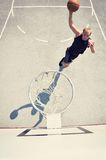 Basketball player in action flying high and scoring Stock Photography