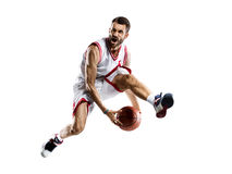 Basketball Player in action. Isolated bg Royalty Free Stock Image