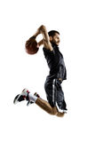 Basketball Player in action. Isolated bg Royalty Free Stock Photography