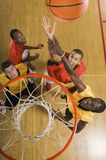 Basketball Player Attempting To Slam Dunk Ball Stock Images