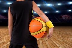 Small steps in a big basketball. Basketball player with ball in gym. Basketball player with ball in gym.Small steps in a big basketball royalty free stock photos