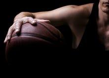 Basketball player. Basketball ball in a hand of the basketball player Stock Photos