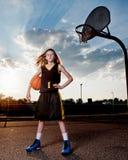 Basketball Player with Ball and Hoop Stock Photo