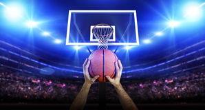 Basketball player with ball. The imaginary basketball arena is modelled and rendered Stock Photo