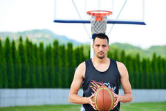 Basketball player with ball at the outdoors basket court royalty free stock photo