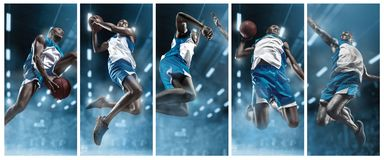 Basketball player on big professional arena during the game. Basketball player making slam dunk. Basketball player in motion or movement on big professional Stock Photo