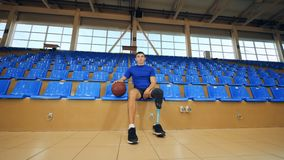 Basketball player with a bionic leg prosthesis, disabled sportsman. 4K stock footage