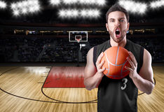 Basketball Player on a black uniform in basketball court Royalty Free Stock Photography