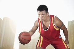 Basketball player, cityscape background Stock Photos