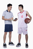 Basketball Player and Coach Stock Photography