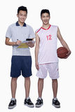 Basketball Player and Coach smiling,  Studio Shot Royalty Free Stock Photo
