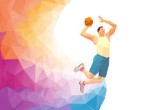Basketball player on colorful low poly back with empty space Royalty Free Stock Photo