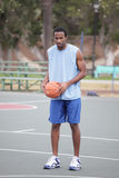 Basketball player on the court Royalty Free Stock Images