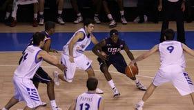 Basketball player dribbling Stock Photo
