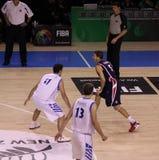 Basketball player dribbling ball Royalty Free Stock Photography