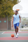 Basketball player dribbling the ball Royalty Free Stock Photography