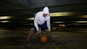Basketball player dribbling the ball quickly stock footage