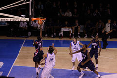 Basketball player dunking Stock Images