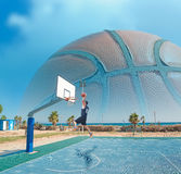 Basketball player dunking by the sea Royalty Free Stock Images