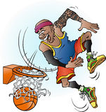 A basketball player dunking Royalty Free Stock Image