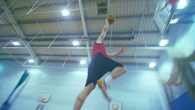 Basketball player dunks the ball stock footage
