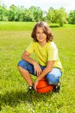 Basketball player after game rest on grass Royalty Free Stock Photo
