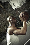 Basketball player going for the win. A closet-up shot of a basketball player Stock Image