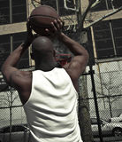 Basketball player going for the win. A closet-up shot of a basketball player Stock Photo