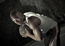 Basketball player guarding ball Royalty Free Stock Image