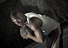 Basketball player guarding ball. A closet-up shot of a basketball player Royalty Free Stock Image