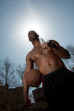 Basketball player guarding ball. A closet-up shot of a basketball player Royalty Free Stock Images