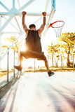 Basketball player hangs on the rim.sport outfit,sport competitions Stock Image