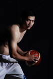 Basketball player hold the ball Royalty Free Stock Photo
