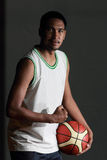 Basketball player hold the ball Royalty Free Stock Image