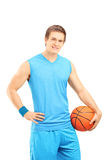 Basketball player holding a ball and looking at camera Stock Images