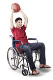 Basketball player holding a ball on the wheelchair Stock Images