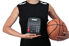 Basketball player holding a calculator Stock Photo